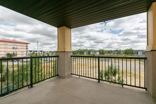 Photo 22: 8329 304 MACKENZIE Way SW: Airdrie Apartment for sale : MLS®# A1128736