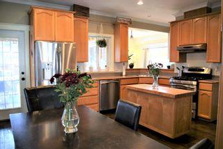 "Photo 6: 34778 6 Avenue in Abbotsford: Poplar House for sale in ""HUNTINGDON VILLAGE"" : MLS®# R2530537"