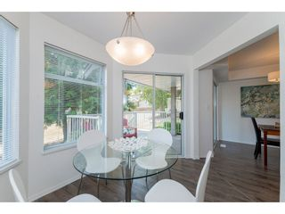 """Photo 9: 210 13900 HYLAND Road in Surrey: East Newton Townhouse for sale in """"Hyland Grove"""" : MLS®# R2295690"""