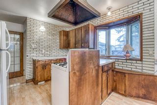 Photo 13: 345 Whitney Crescent SE in Calgary: Willow Park Detached for sale : MLS®# A1061580