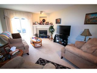 Photo 4: 2 117 BOW RIDGE Drive: Cochrane House for sale : MLS®# C4003118