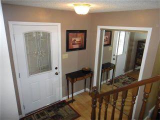 Photo 4: 351 WOODFIELD Road SW in Calgary: Woodbine House for sale : MLS®# C4050173