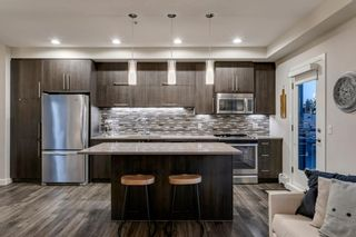 Photo 5: 405 93 34 Avenue SW in Calgary: Parkhill Apartment for sale : MLS®# A1095542