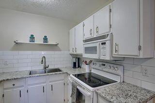 Photo 8: 2 14736 Deerfield Drive SE in Calgary: Deer Run Row/Townhouse for sale : MLS®# A1075072