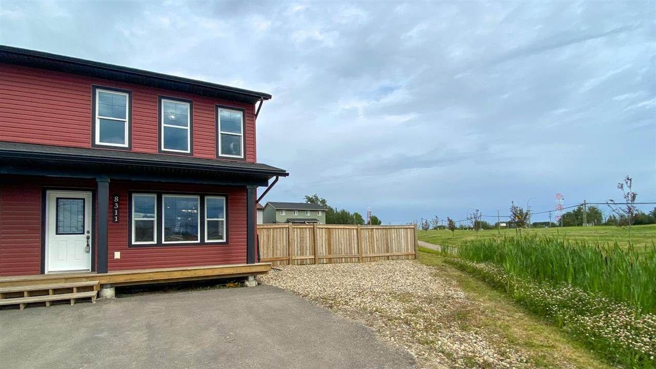 Main Photo: 8311 88 Street in Fort St. John: Fort St. John - City SE 1/2 Duplex for sale (Fort St. John (Zone 60))  : MLS®# R2480271
