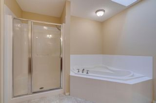 Photo 22: 144 Tuscany Meadows Heath NW in Calgary: Tuscany Detached for sale : MLS®# A1030703