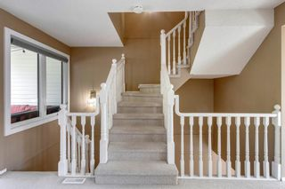 Photo 14: 81 Coachway Gardens SW in Calgary: Coach Hill Row/Townhouse for sale : MLS®# A1147900