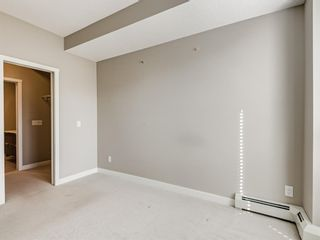 Photo 14: 216 823 5 Avenue NW in Calgary: Sunnyside Apartment for sale : MLS®# A1078604