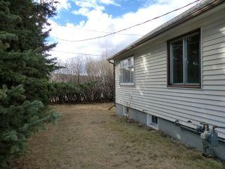 Photo 5: 204 CENTRE Avenue: Cochrane House for sale : MLS®# C4055784