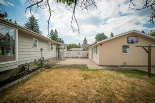 Photo 5: 12023 Candiac Road SW in Calgary: Canyon Meadows Detached for sale : MLS®# A1128675