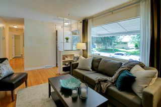 Photo 3: 50 FRASER Road SE in Calgary: Fairview Detached for sale : MLS®# A1145619