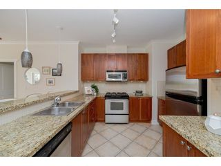 """Photo 6: 102 4500 WESTWATER Drive in Richmond: Steveston South Condo for sale in """"COPPER SKY WEST"""" : MLS®# R2266032"""