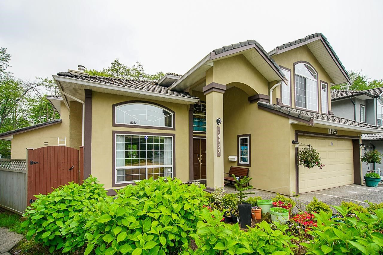 Main Photo: 14339 74A Avenue in Surrey: East Newton House for sale : MLS®# R2604983