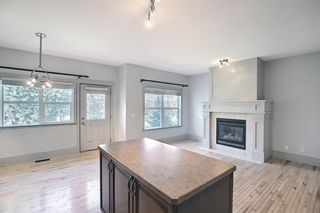 Photo 14: 63 Wentworth Common SW in Calgary: West Springs Row/Townhouse for sale : MLS®# A1124475