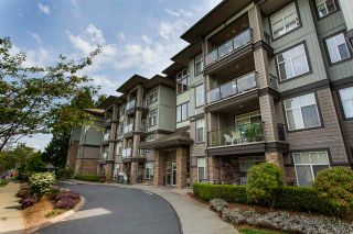 """Photo 1: 408 33338 MAYFAIR Avenue in Abbotsford: Central Abbotsford Condo for sale in """"The Sterling"""" : MLS®# R2456135"""