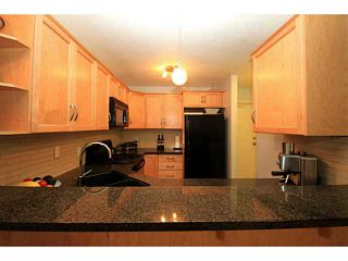Photo 4: 161 76 GLAMIS Green SW in CALGARY: Glamorgan Stacked Townhouse for sale (Calgary)  : MLS®# C3572473