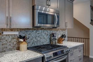 Photo 9: 157 Sunset Point: Cochrane Row/Townhouse for sale : MLS®# A1132458