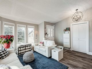 Photo 2: 71 Strathaven Circle SW in Calgary: Strathcona Park Detached for sale : MLS®# A1079924