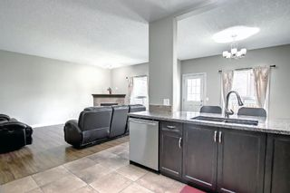 Photo 7: 115 Everhollow Street SW in Calgary: Evergreen Detached for sale : MLS®# A1145858