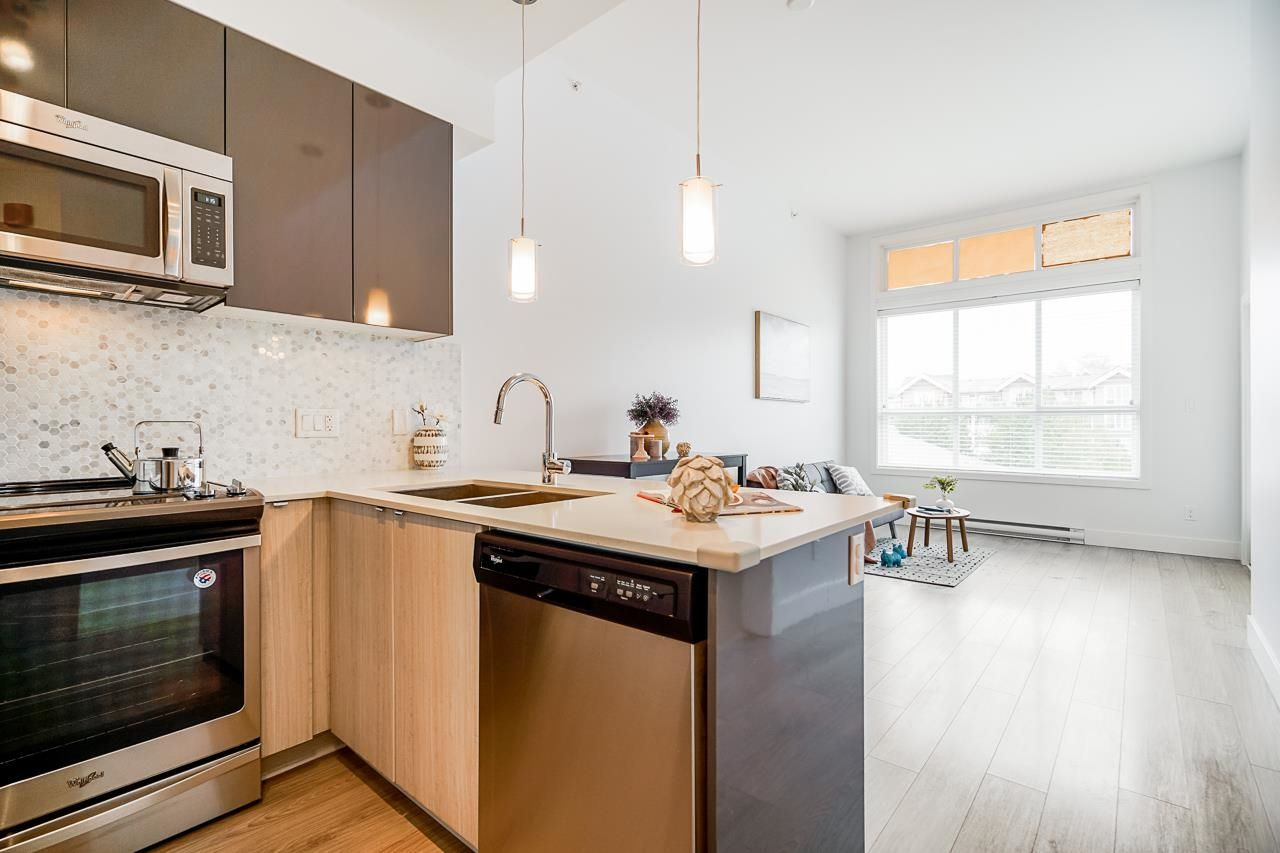 """Main Photo: 405 6468 195A Street in Surrey: Clayton Condo for sale in """"YALE BLOC"""" (Cloverdale)  : MLS®# R2616487"""