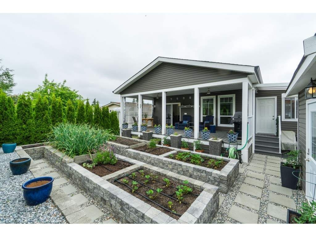 "Main Photo: 205 3665 244 Street in Langley: Otter District Manufactured Home for sale in ""Langley Grove Estates"" : MLS®# R2372975"