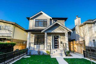Photo 1: 8373 LAUREL Street in Vancouver: Marpole 1/2 Duplex for sale (Vancouver West)  : MLS®# R2425868