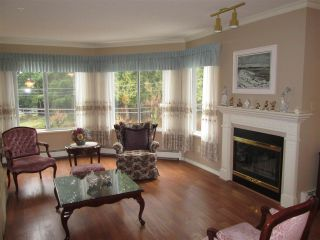 """Photo 8: 210 2451 GLADWIN Road in Abbotsford: Abbotsford West Condo for sale in """"Centennial Court"""" : MLS®# R2145469"""