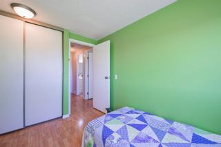 Photo 36: 332 Queenston Heights SE in Calgary: Queensland Row/Townhouse for sale : MLS®# A1114442