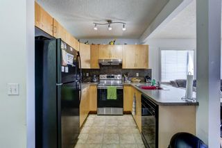 Photo 4: 388 Panatella Boulevard NW in Calgary: Panorama Hills Row/Townhouse for sale : MLS®# A1114400