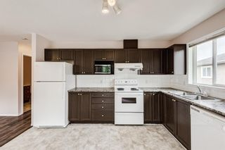 Photo 8: 6633 Pinecliff Grove NE in Calgary: Pineridge Row/Townhouse for sale : MLS®# A1128920