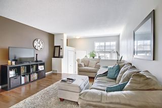 Photo 7: 3028 New Brighton Gardens SE in Calgary: New Brighton Row/Townhouse for sale : MLS®# A1125988