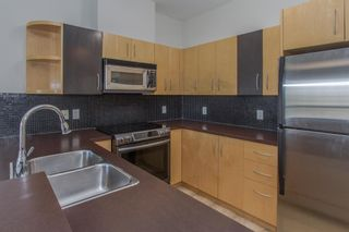 Photo 4: 328 69 Springborough Court SW in Calgary: Springbank Hill Apartment for sale : MLS®# A1124627