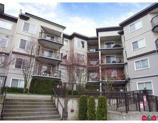 "Photo 1: 106 5765 GLOVER Road in Langley: Langley City Condo for sale in ""College Court"" : MLS®# F2712182"
