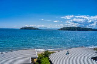 """Photo 1: 6500 WILDFLOWER Place in Sechelt: Sechelt District Townhouse for sale in """"WAKEFIELD BEACH - 2ND WAVE"""" (Sunshine Coast)  : MLS®# R2604222"""
