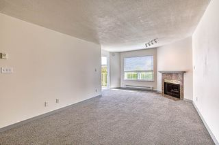Photo 3: 308 9948 151 Street in Surrey: Guildford Condo for sale (North Surrey)  : MLS®# R2402381