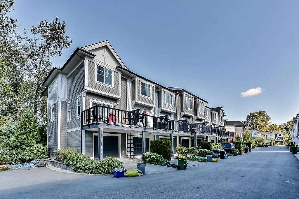 """Main Photo: 105 3010 RIVERBEND Drive in Coquitlam: Coquitlam East Townhouse for sale in """"WESTWOOD"""" : MLS®# R2109754"""