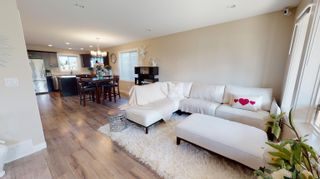 Photo 2: 8810 76 Street in Fort St. John: Fort St. John - City SE 1/2 Duplex for sale (Fort St. John (Zone 60))  : MLS®# R2620335