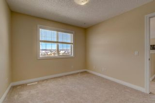Photo 39: 204 SUNTERRA Boulevard: Cochrane House for sale : MLS®# C4164735