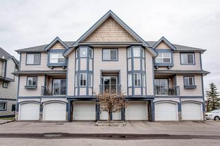 Photo 1: 119 Eversyde Point SW in Calgary: Evergreen Row/Townhouse for sale : MLS®# A1048462
