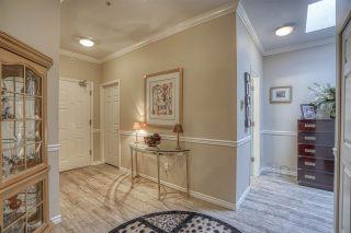 "Photo 3: 308 1150 54A Street in Delta: Tsawwassen Central Condo for sale in ""LEXINGTON"" (Tsawwassen)  : MLS®# R2442881"