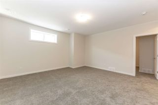 Photo 31: 8128 222 Street in Edmonton: Zone 58 House Half Duplex for sale : MLS®# E4228102