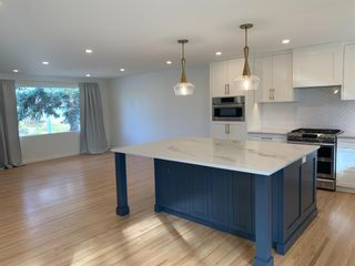 Photo 4: 5832 Lodge Crescent SW in Calgary: Lakeview Detached for sale : MLS®# A1046811