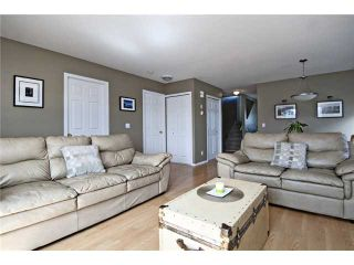 Photo 2: 113 55 FAIRWAYS Drive NW: Airdrie Townhouse for sale : MLS®# C3565868