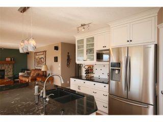 Photo 19: 51 GLENEAGLES View: Cochrane House for sale : MLS®# C4008842