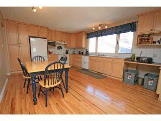 Photo 5: 1527 LAKE TWINTREE Way SE in CALGARY: Lake Bonavista Residential Detached Single Family for sale (Calgary)  : MLS®# C3602215