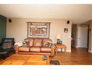 Photo 11: 51 GLENEAGLES View: Cochrane House for sale : MLS®# C4008842
