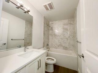 "Photo 8: 218 9983 E BARNSTON Drive in Surrey: Fraser Heights Condo for sale in ""COAST"" (North Surrey)  : MLS®# R2622739"