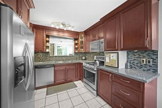 Photo 7: 4225 BIRCHWOOD Crescent in Burnaby: Greentree Village Townhouse for sale (Burnaby South)  : MLS®# R2501600