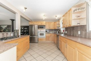 Photo 6: 703 KNOTTWOOD Road S in Edmonton: Zone 29 House for sale : MLS®# E4261398