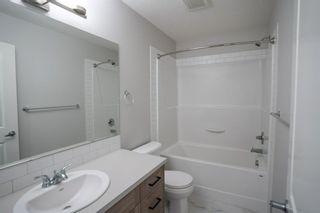 Photo 33: 1601 250 fireside Drive: Cochrane Row/Townhouse for sale : MLS®# A1143826